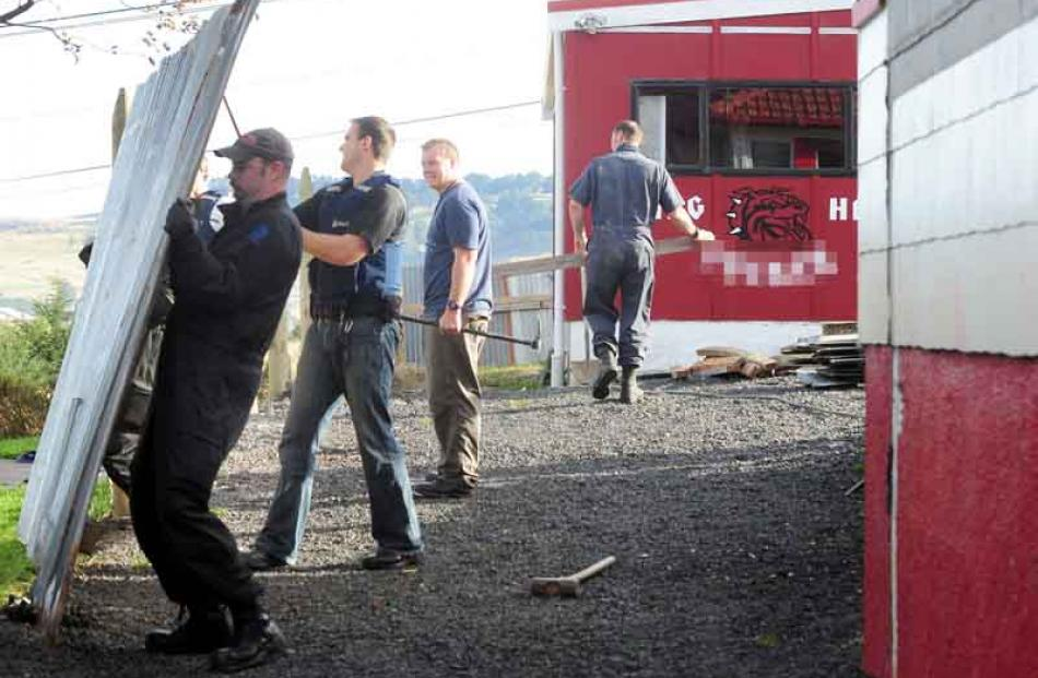 Police demolish another section of fence from the former Mongrel Mob Aotearoa headquarters.
