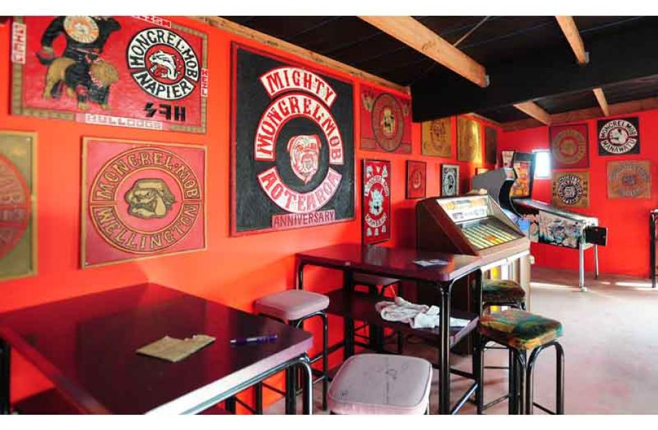 The well-equipped clubroom, with various Mongrel Mob insignia emblazoned on the wall.
