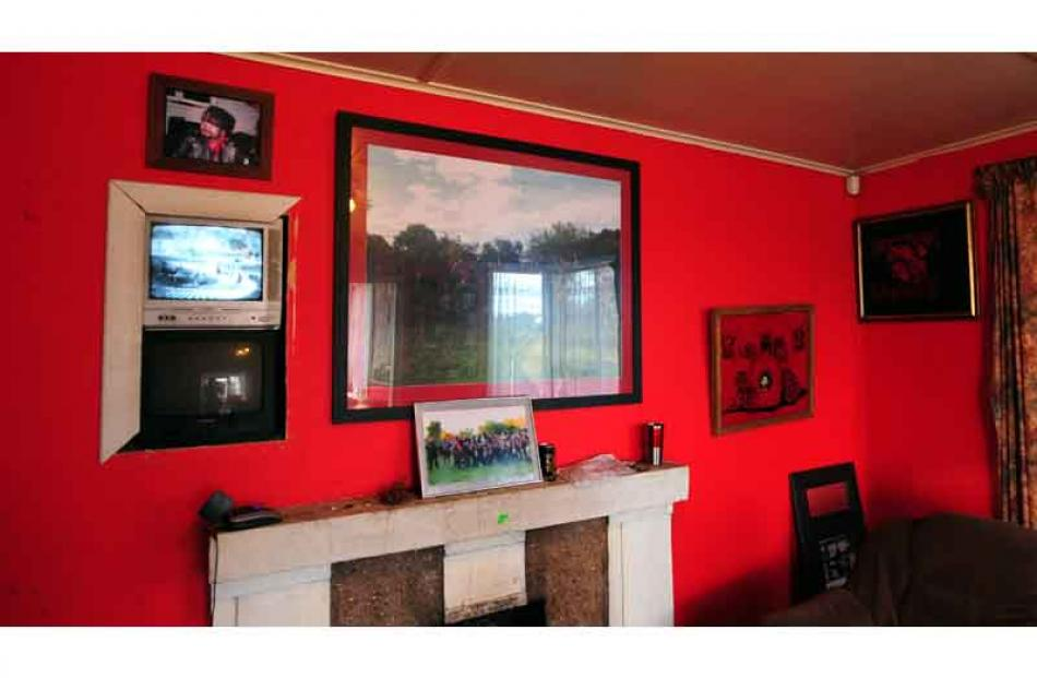 A glimpse into the lounge of the Mongrel Mob Aotearoa, which features CCTV monitors, and pictures...