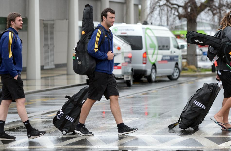 Highlander players (from left) Liam Squire, Tom Franklin and Dan Pryor leave Dunedin Airport...