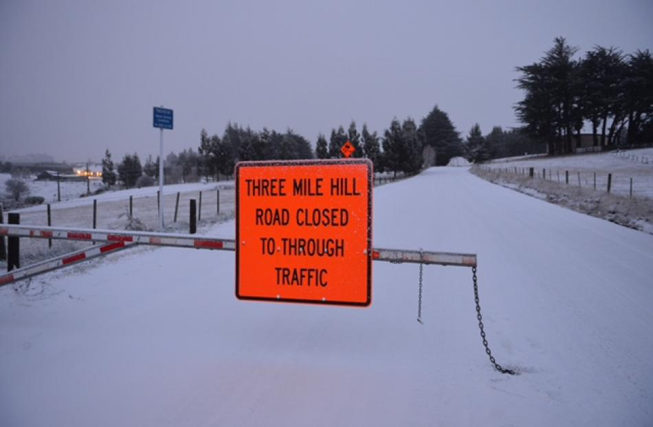 Three Mile Hill road is closed today. Photo Stephen Jaquiery