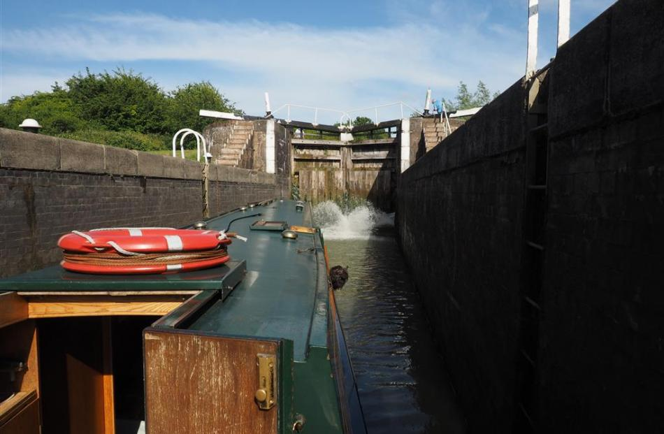Water surges through the paddles at the bottom of the lock gates.