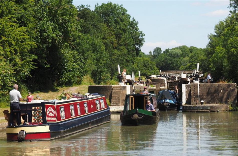 Most canal-boaters enjoy the chance to chat and compare notes while negotiating locks.