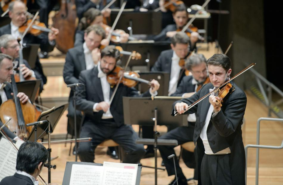 Noah Bendix-Balgley playing with the Berlin Philharmonic. Photo by Monka Rittershaus.