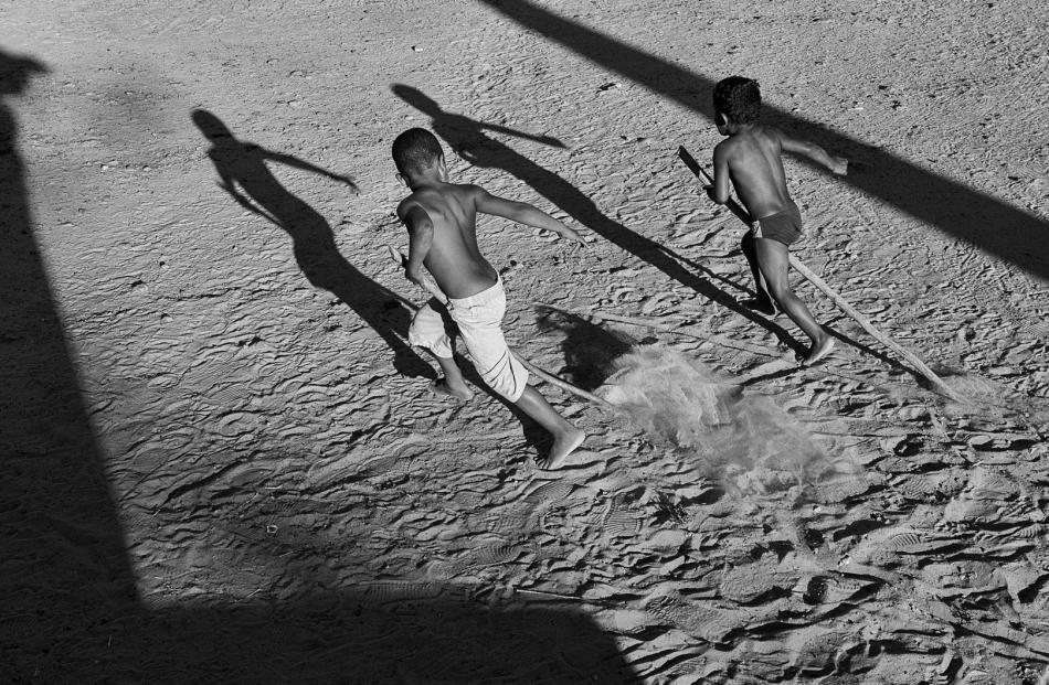 Two little boys horse racing, Piaui, Brazil.