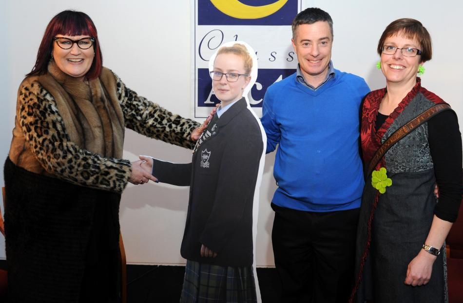 Blue Mountain College principal Lindy Cavanagh-Monaghan congratulates a cardboard cut-out of year...