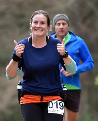 Amy Watts (Alexandra)  looking happy after lap 1.