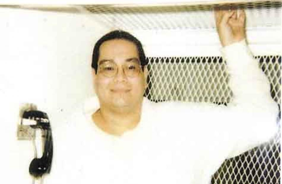 Charles Don Flores in an escape-proof visitation booth at Polunsky Unit, South Livingston, Texas.