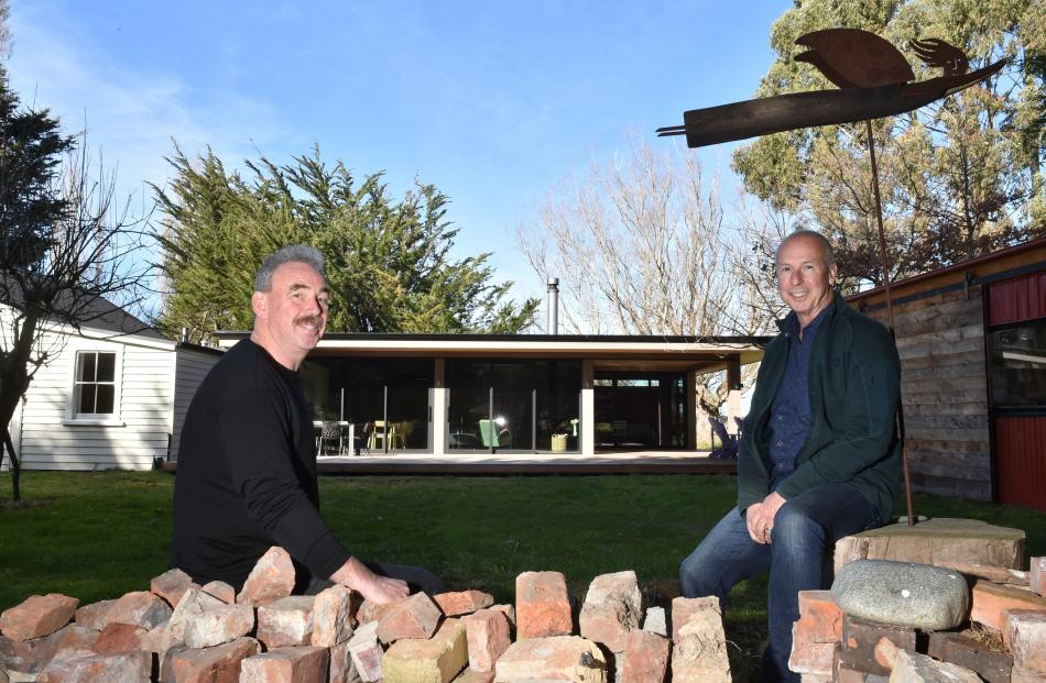 Opening up the cottage at the rear has made it much more liveable, says co-owner John Forster (right), pictured with architectural designer Gary Todd, sitting beside bricks from a demolished chimney. Photo: Gregor Richardson