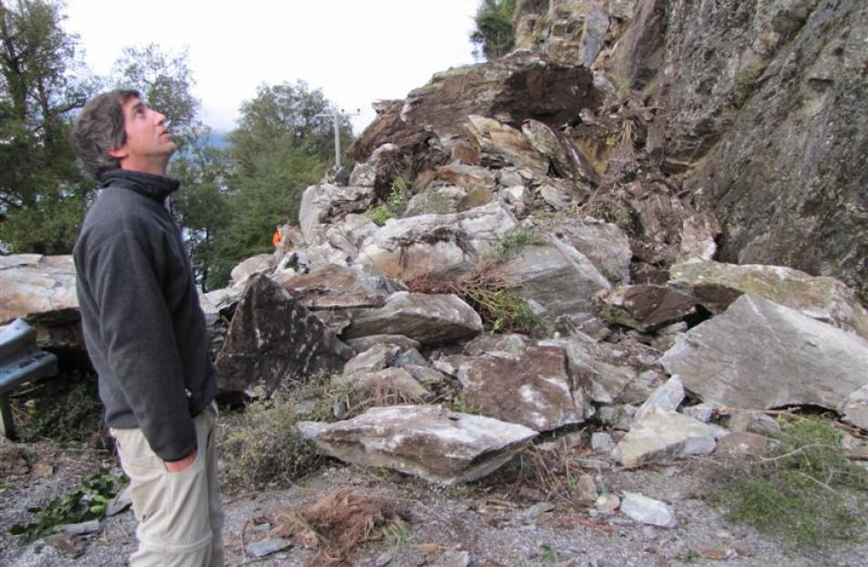 Queenstown resident Chris Johnson surveys the rockslide which spoiled his group's plans to go...
