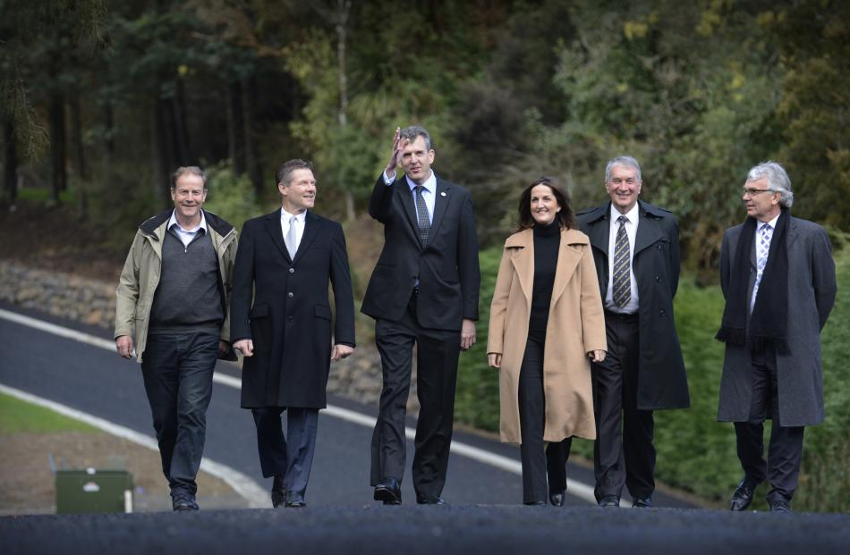 Strolling on Fred Hollows Way in Dunedin are (from left) developer John Dunckley, Australian High Commissioner to New Zealand Peter Woolcott, Fred Hollows Foundation executive director Andrew Bell, Fred's daughter Tanya Woolcott, and foundation board memb
