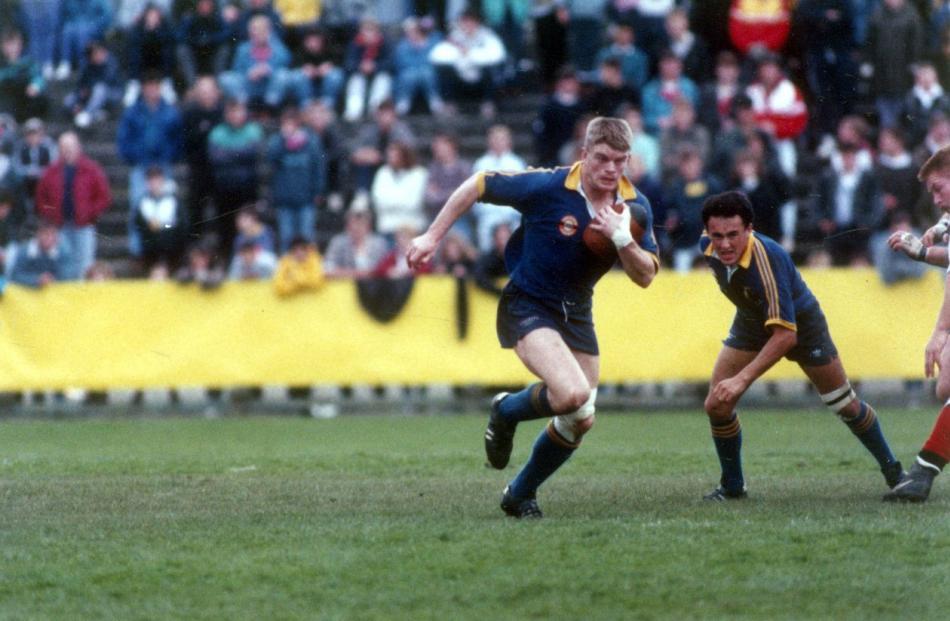 Otago hooker David Latta is backed up by halfback Stu Forster.
