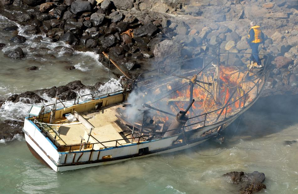 Smoke rises from the burning boat. Photos by Stephen Jaquiery.