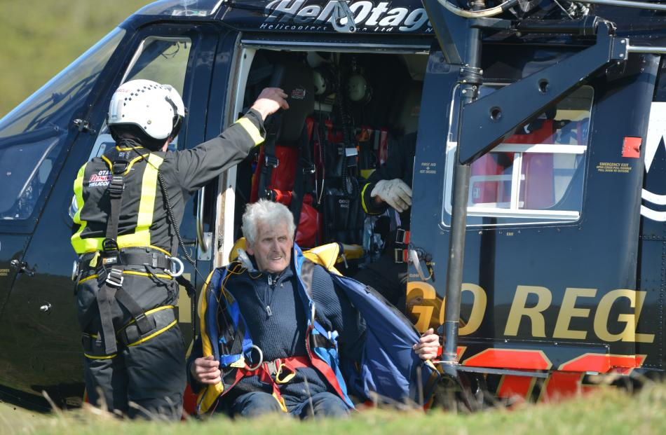 Port Chalmers fisherman Warren Lewis is winched to safety by rescue helicopter after his boat Renegade caught fire off Heyward Point, near Dunedin, yesterday.