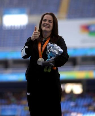 Holly Robinson celebrates with her silver medal. Photo Reuters