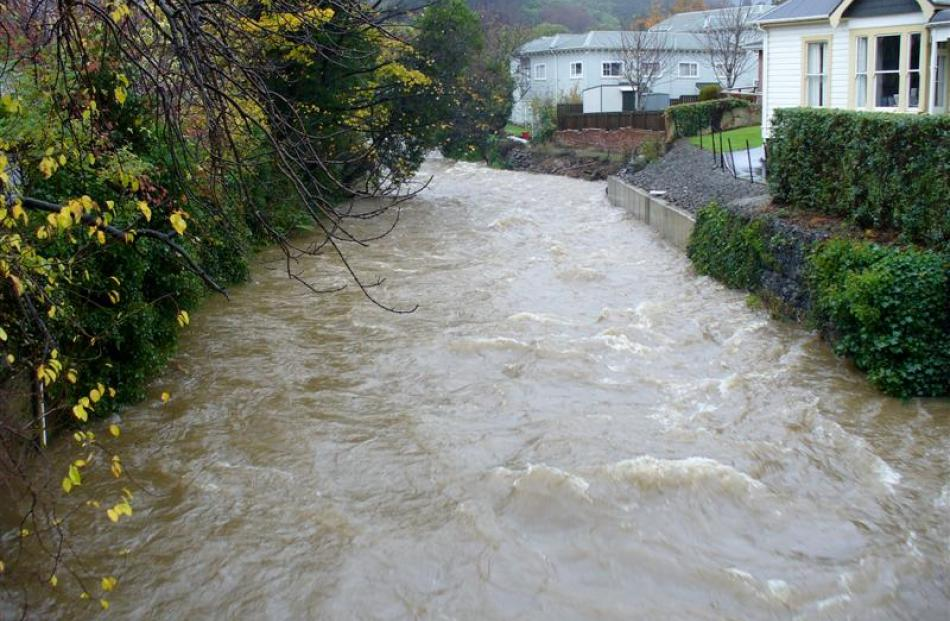 The Water of Leith running high near the University of Otago foot-bridge. Photo by Webfeatpix