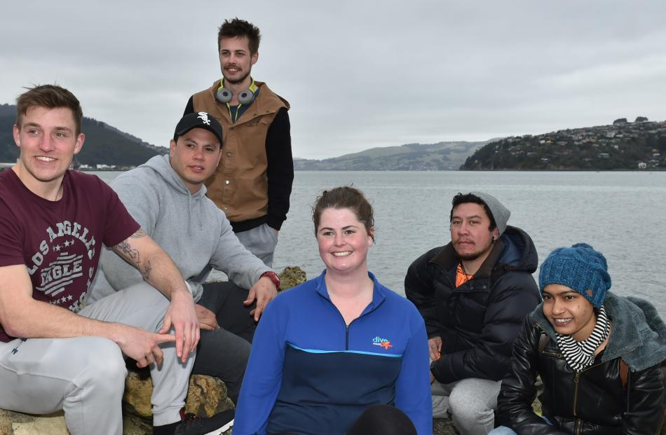 Dive Otago students Reece Groenendal (21), Tama Samuel (26), Jordan Read (23), instructor Gina Watts (23), Shane Timu (30) and Devlina Sinha (30), all of Dunedin, were lucky enough to be entertained by a whale in Otago Harbour. Photo by Gregor Richardson.
