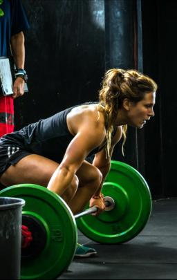 CrossFit athlete Jamie Greene prepares to lift a weights bar earlier this year. PHOTO: SUPPLIED
