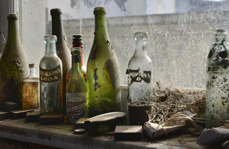Old bottles were among the treasures uncovered in the wall and floor cavities of the building.