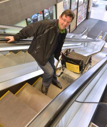 Cr Whiley finishes his wheelchair ride by taking the escalator at the Civic Centre.