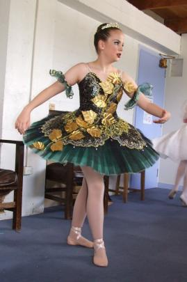 Anna Morris (12) , of Invercargill, goes through her ballet routine backstage.