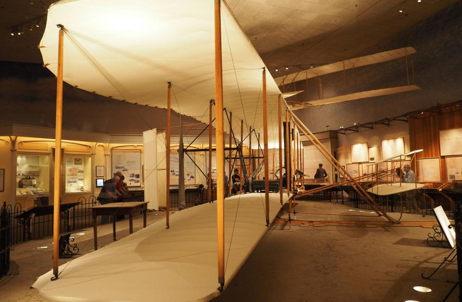 The Wright Flier, constructed of wood, muslin and carrying a 12-horsepower engine, made a 12...