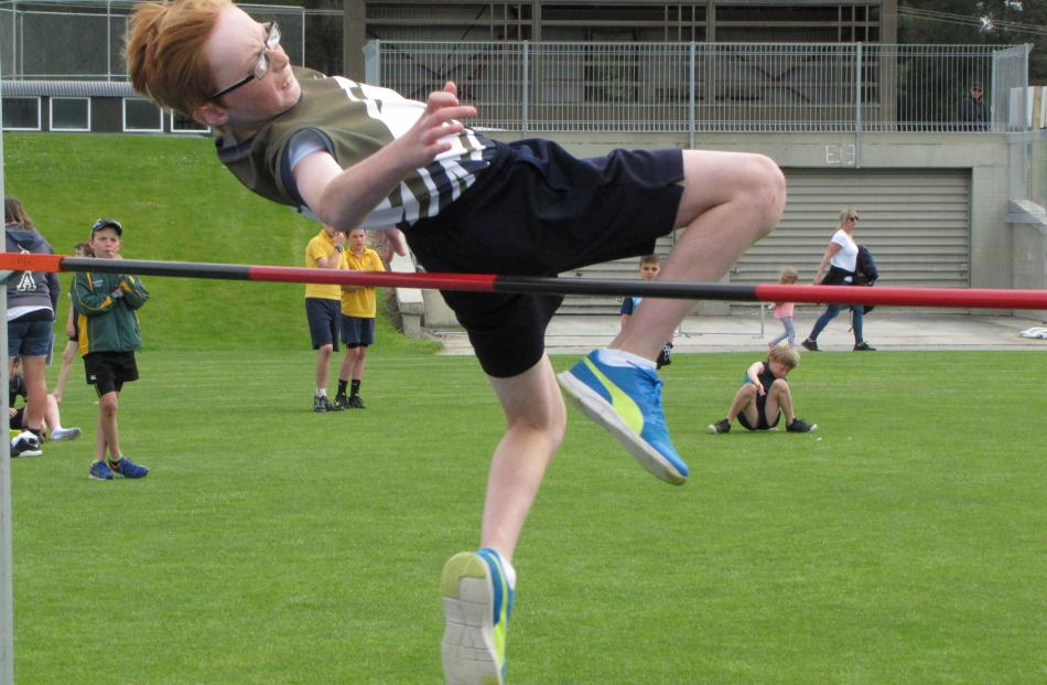 Remarkables Primary School pupil Alfie Pye (11) Fosbury flops his way to victory in the under-12 boys' high jump yesterday. Photos by Jono Edwards.