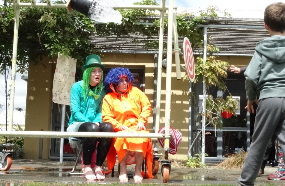Year 7 teacher Alice Denley (left) and year 3 teacher Yvonne Culling were repeatedly soaked. Photos by David Williams.
