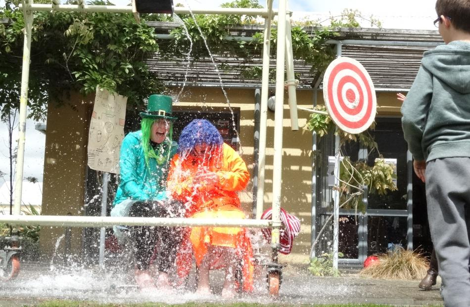 Year 7 teacher Alice Denley (left) and year 3 teacher Yvonne Culling were repeatedly soaked.