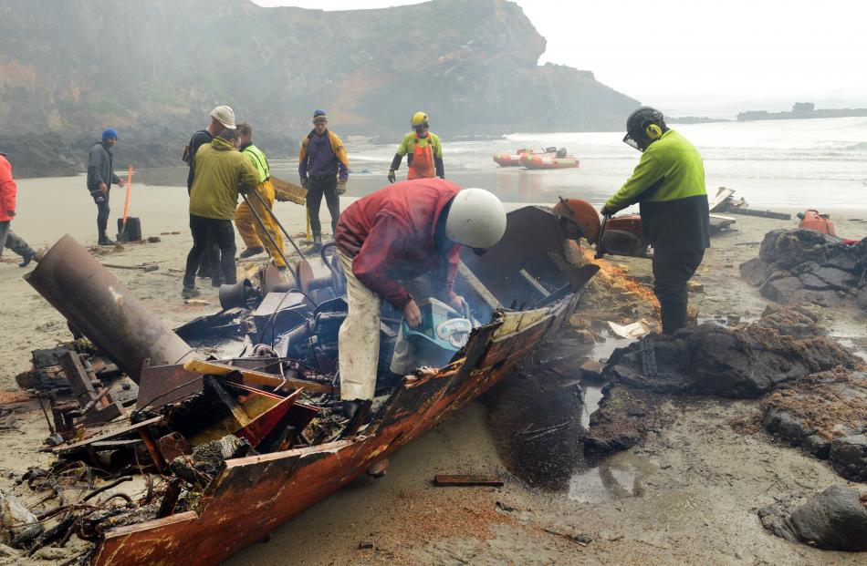 Much of the wreck of Renegade is gone after a salvage crew dismantled the structure on a remote beach at Heyward Point on Tuesday. Photos by Stephen Jaquiery