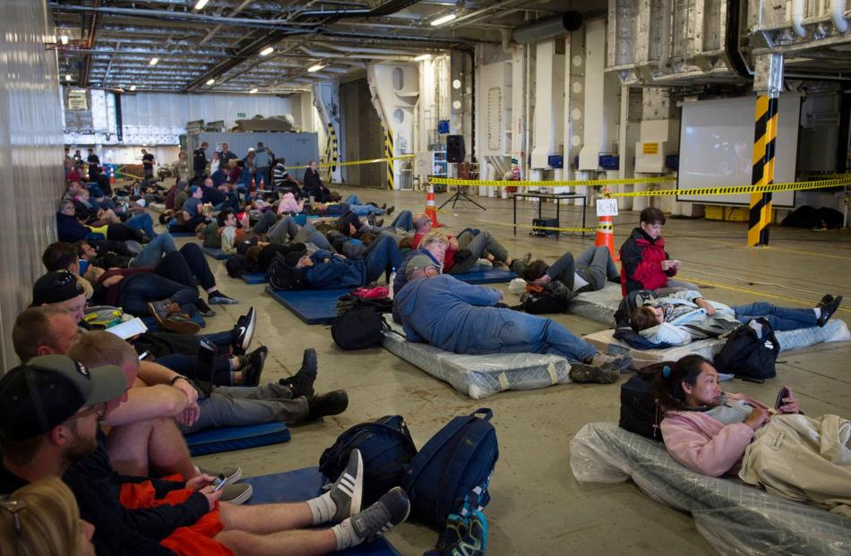 Evacuees who had been stranded in the earthquake-affected Kaikoura rest aboard Royal New Zealand Navy ship HMNZS Canterbury. Photo from Reuters.