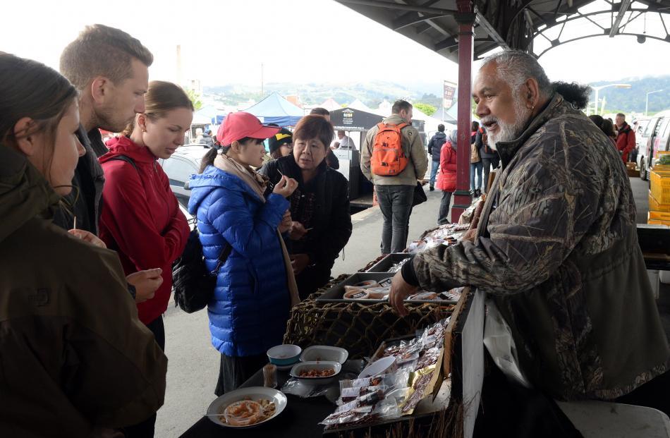 Wild Smokehouse owner Joe Ruka demonstrates his products at Otago Farmers Market.
