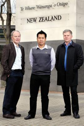 Dr Htin Lin Aung (centre) with microbiology and immunology department professor Greg Cook (left)...