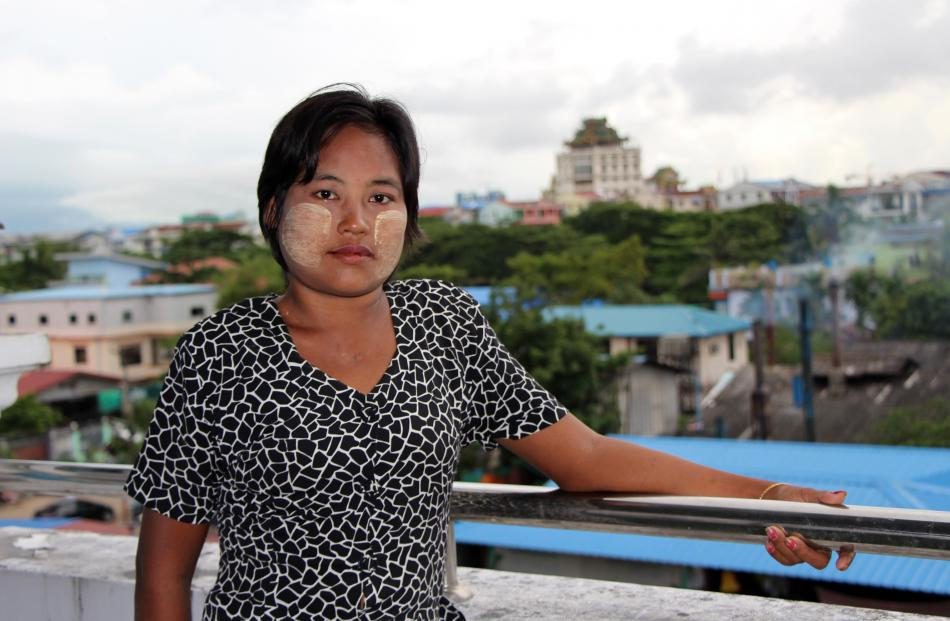Nwe Nwe Oo (28), of Yangon, and her family regularly went without food when she was forced to...