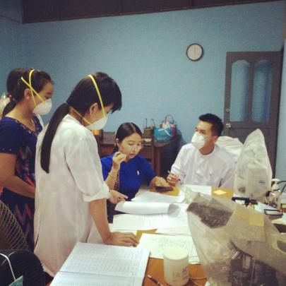 Dr Htin Lin Aung (right) discusses research data with staff at a Tb clinic in northern Yangon,...