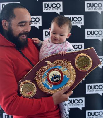 Che Cooper and Ivy Cooper-Waldron (9 months) take hold of  the WBO heavyweight belt custom-made...