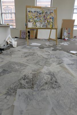 Bush begins by drawing on tracing paper, which litters the floor in her studio. Photo by Gerard O'Brien.