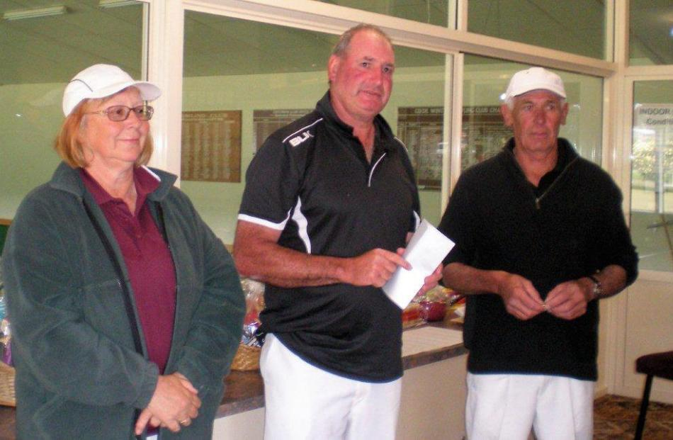 Alexandra's Trevor Drake (centre) and Steve Rabbette, who won the Central Otago men's pairs. Also...