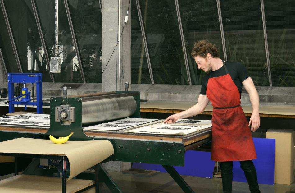 Paul McLachlan during a marathon 19-hour printing session in Canterbury University's Ilam Print Studio, where he produced the Bangkok-inspired lithographs for Chambers Gallery. Photos supplied.