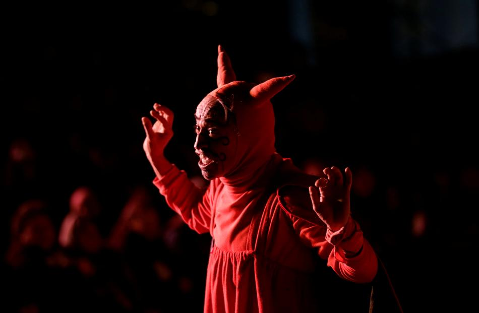 An actor dressed as the devil participates in a traditional Christmas presentation, known as the...