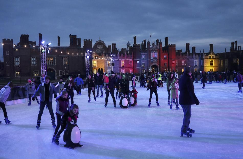 People skate on the ice rink at Hampton Court Palace in London. Photo: Reuters