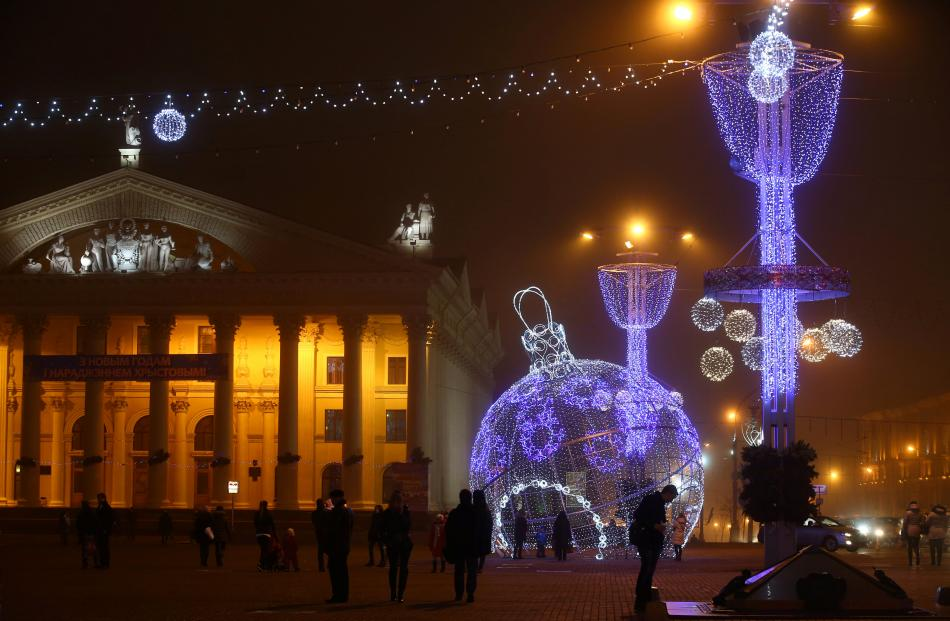 A giant bauble lit up in Oktyabrskaya Square in Minsk. Photo: Reuters