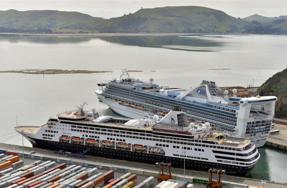 The cruise ships Maasdam (left) and Golden Princess in Port Chalmers yesterday.PHOTO: GERARD O'BRIEN