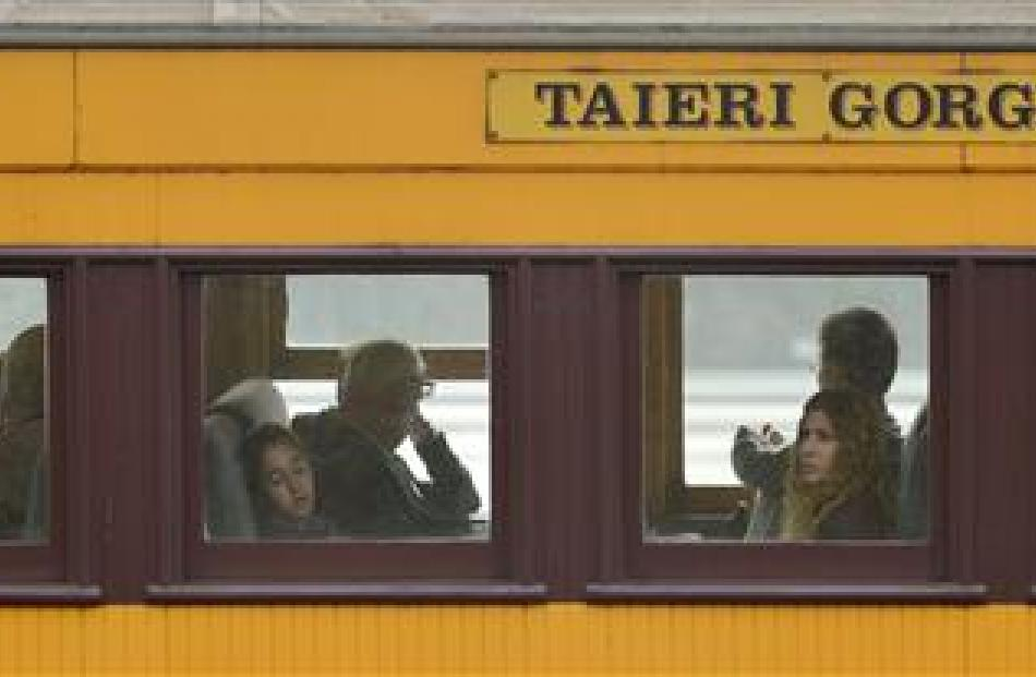 Passengers from the cruise ships Maasdam and Golden Princess travel on a Dunedin Railways train...