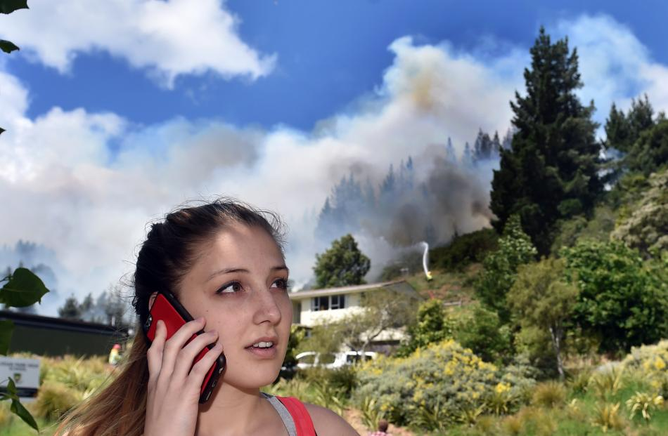 Rachel Neynens, of Dunedin, says she called emergency services after seeing flames licking trees. Photo by Peter McIntosh.
