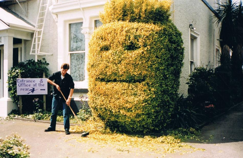 Sandra Scott-Harrison with ''Wilson'', her topiary hedge in Christchurch. Photo by Sandra Scott-Harrison.