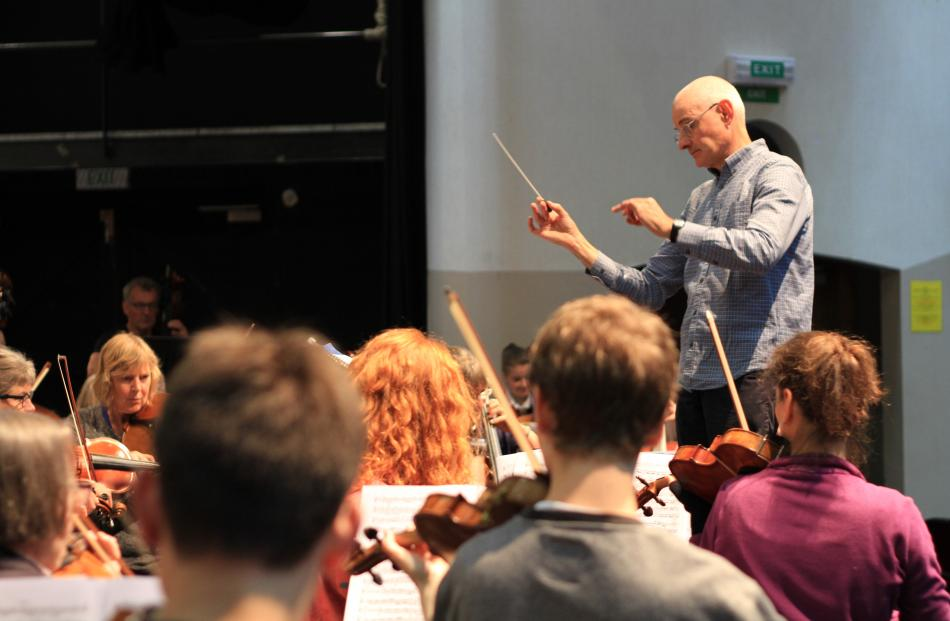 Prof Peter Adams conducts the first full orchestra rehearsal. PHOTOS: HAMISH MACLEAN
