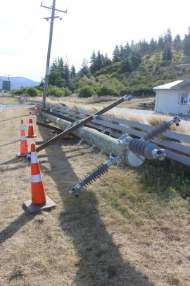 A power pole is blown over on the outskirts of Cromwell.