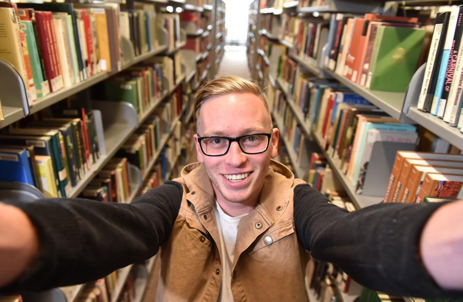 University of Otago summer school student Callum Doyle (20), in the university library, says a...