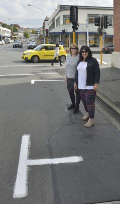 Jill Dalwood (left) and Charmaine Mundy stand in a metered Dunedin City Council car park in Filleul St yesterday.